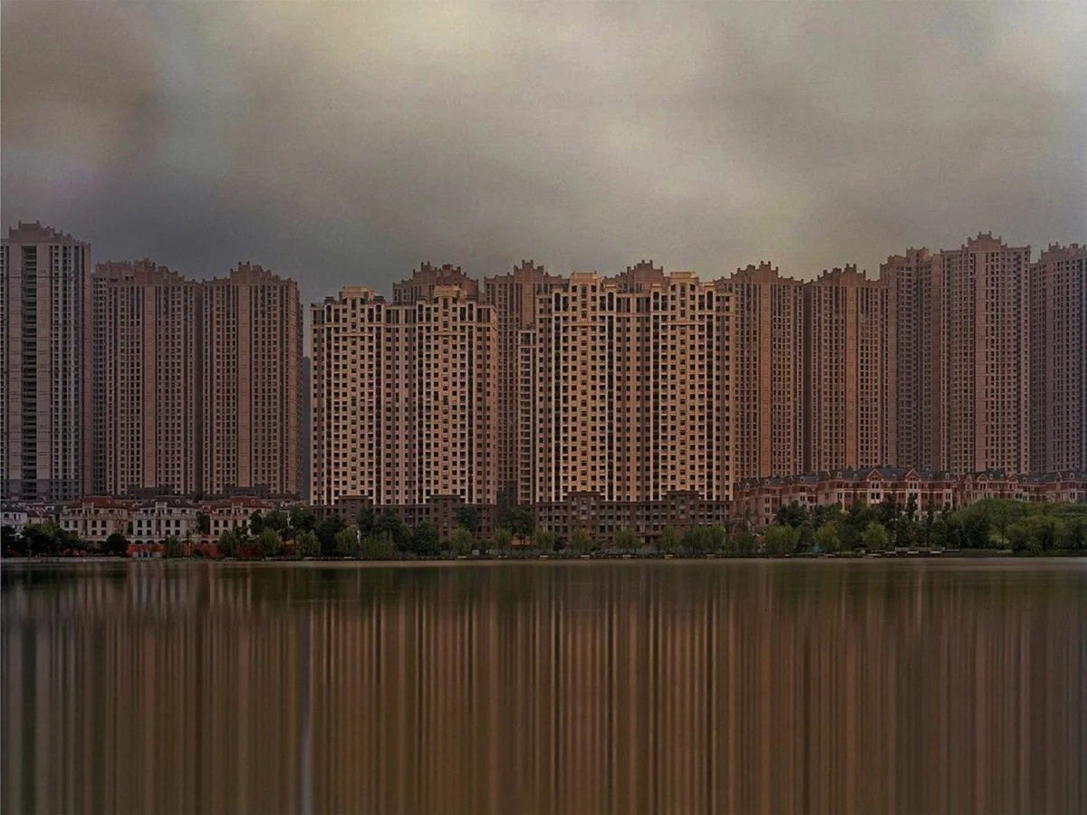 Why are many ghost cities being built in China?